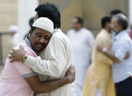Muslims hugging each other